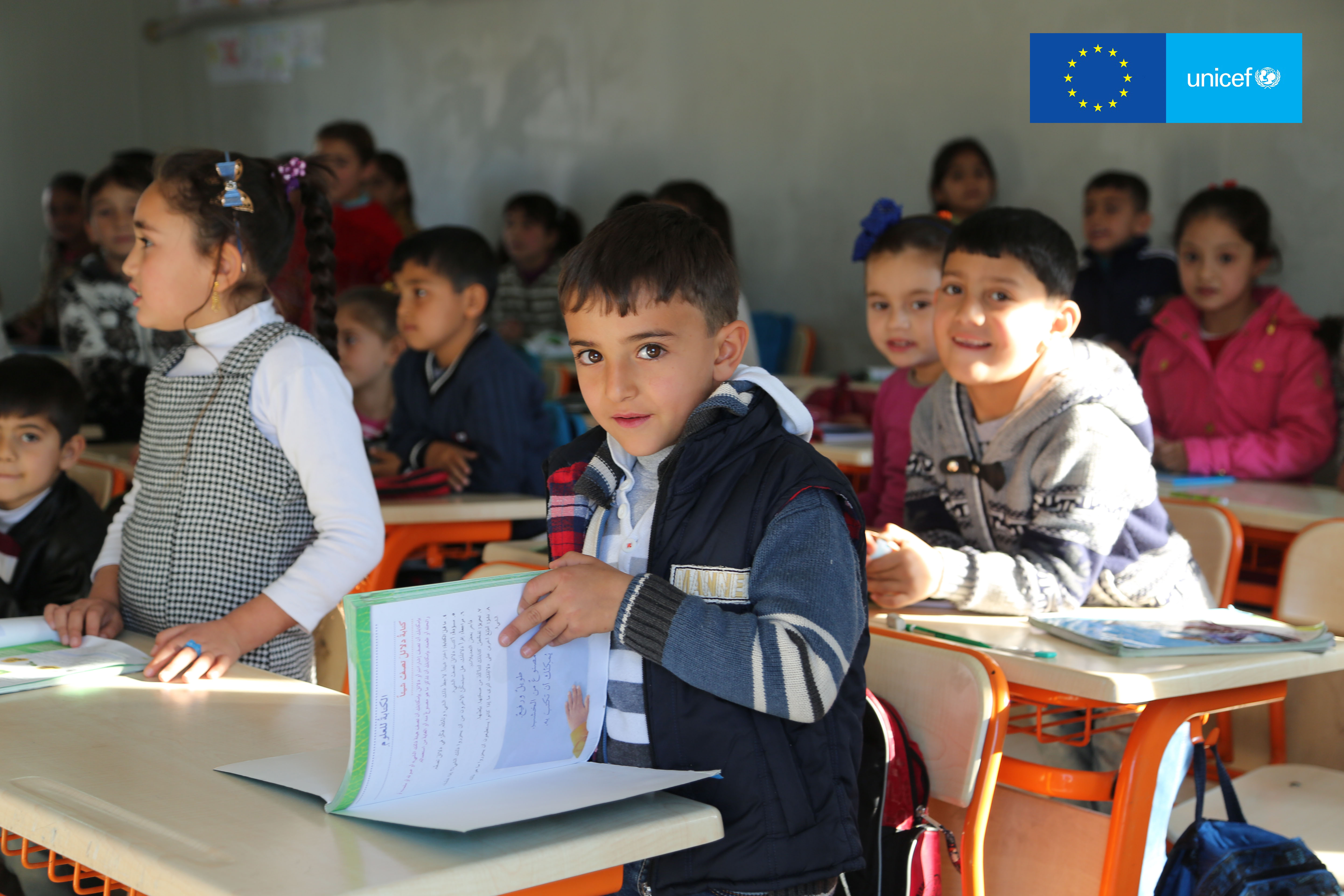 A student opens his textbook at the start of a lesson at the Temporary Education Center in Osmaniye, southern Turkey, March 2016. Credit: UNICEF Turkey/2016/Ergen