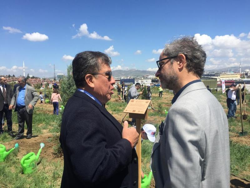 gabriel vinals munera and bulent ozcan at the tree planting ceremony for europe day 19