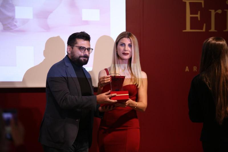 Ozan Takis with the award