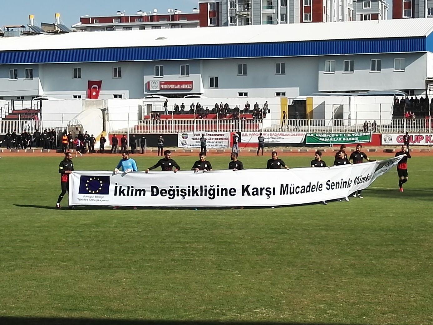 Local Vanspor soccer game started with a banner displayed by players with the EU Climate Action message.