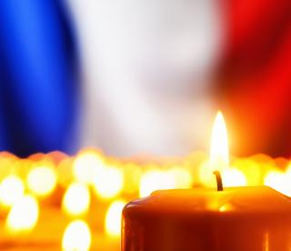 candles in front of a French flag