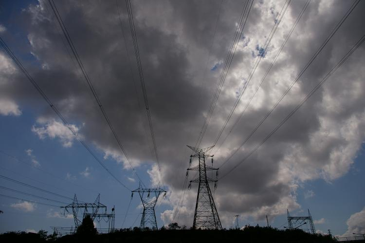 Electric wires under clouds