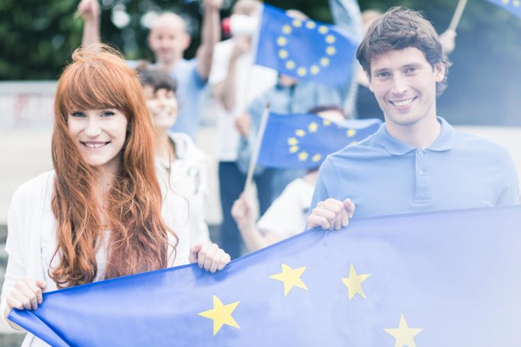 Young adults holding EU flag