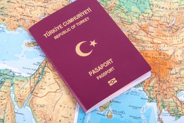 A Turkish passport on a map